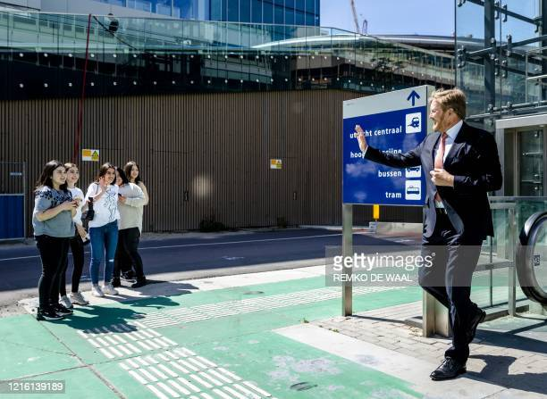 King WillemAlexander of the Netherlands waves to girls during a visit to the Dutch railway company NS at the central station in Utrecht the...