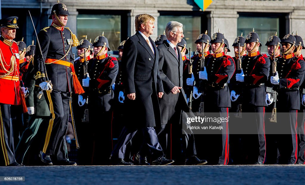 King Willem-Alexander of the Netherlands welcomes King Philippe of Belgium during an official welcome ceremony at the Dam Square in the front of the Royal Palace at the start of the three-day state visit on 28 November 2016 in Amsterdam, The Netherlands.