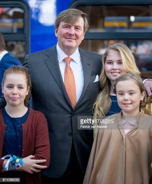 King Willem-Alexander, Princess Amalia, Princess Alexia and Princess Ariane of The Netherlands attend the King's 50th birthday during the Kingsday...
