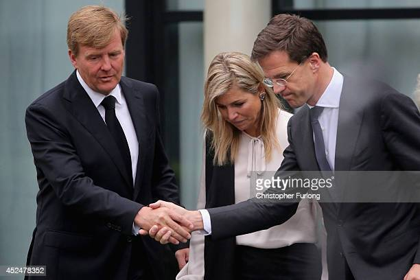 King WillemAlexander Queen Maxima and Dutch Prime Minister Mark Rutte leave the Congresscentrum Utrecht after meeting relatives of the victims of...