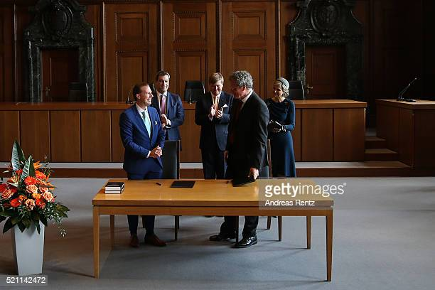 King WillemAlexander Queen Maxima of the Netherlands and Bavarian Minister of Ecnomic Affairs Markus Soeder applaud Director of Grotius Centre...