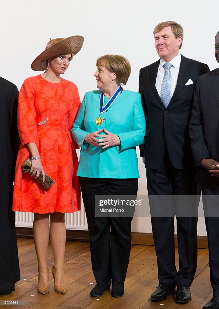 King Willem-Alexander, Queen Maxima of The Netherlands and German Chancellor Angela Merkel pose for a photo after attending the Four Freedoms Awards on April 21, 2016 in Middelburg Netherlands.