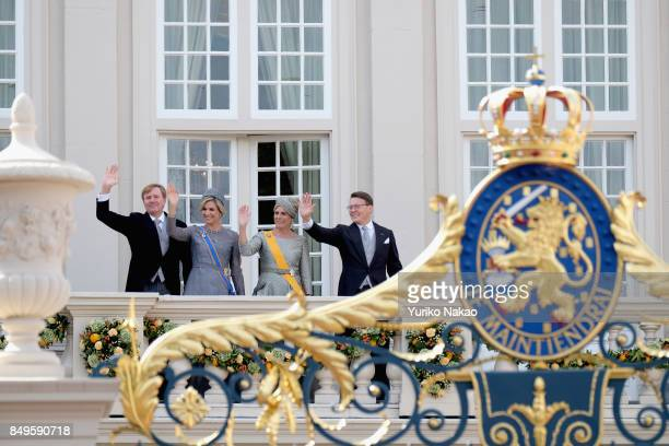 King WillemAlexander Queen Maxima Princess Laurentien and Prince Constantijn wave at the balcony of Palace Noordeinde during the Prinsjesdag on...