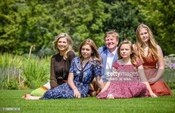 King WillemAlexander Queen Maxima princesses CatharinaAmalia Ariane and Alexia pose for the annual royal photo session in the garden of Huis ten...