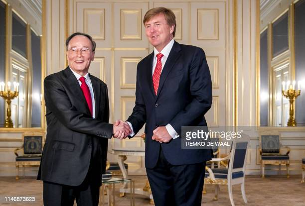 King WillemAlexander receives Chinese vice president Wang Qishan during an audience at Noordeinde Palace in the Hague on May 29 2019 during a visit...