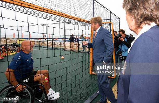 King Willem-Alexander, seen in an informal conversation with a visitor during the TeamNL Olympic Festival on the sports beach of The Hague. H.R.H....