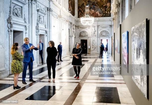 King Willem-Alexander speaks with a winner of the Royal Prize for Free Painting 2021 in the Royal Palace of Amsterdam, on July 14 as King...