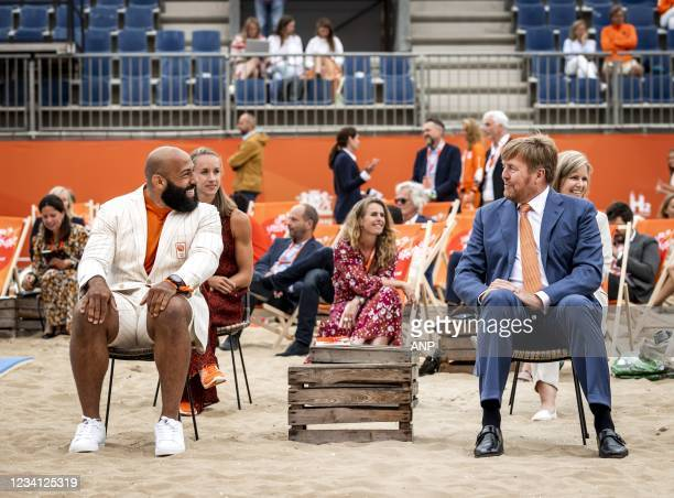 King Willem-Alexander talks with judoka Roy Meyer during the opening of TeamNL Olympic Festival on the sports beach of The Hague. The three-week...