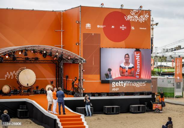 King Willem-Alexander wishes swimmer Ranomi Kromowidjojo good luck in Tokyo during the opening of TeamNL Olympic Festival on the sports beach in The...