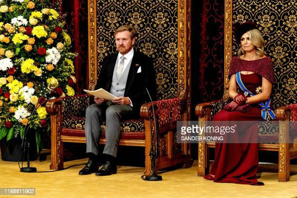 King WillemAlexander with Queen Maxima by his side delivers his speech to members of the Upper and Lower Chamber in the Ridderzaal in The Hague on...