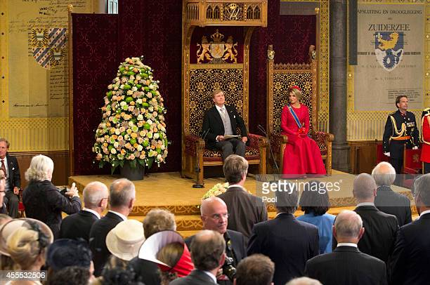 King WillemAlexander with Queen Maxima of the Netherlands delivers an address to the government on budget day in the Hall of Knights on September 16...