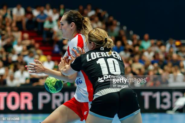 Kinga Achruk of Poland and Anna Loerper of Germany battle for the ball during the Women's handball International friendly match between Germany and...