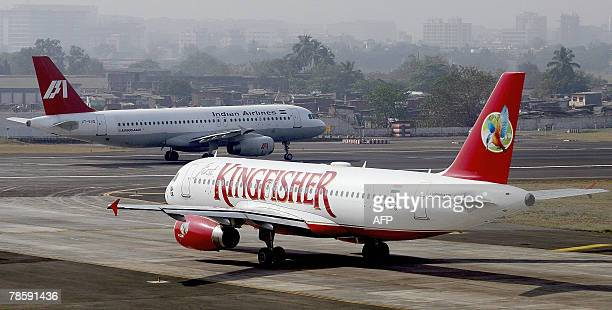 A Kingfisher Airline flight awaits clearance to take off from the city airport in Mumbai 20 December 2007 India's biggest discount carrier Deccan...