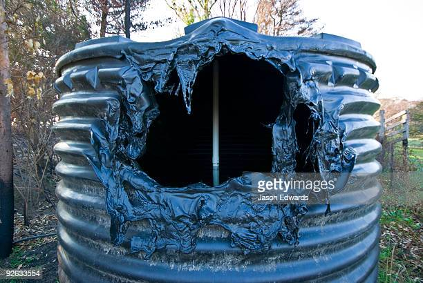 A plastic water tank melted in the extreme heat of a forest fire.