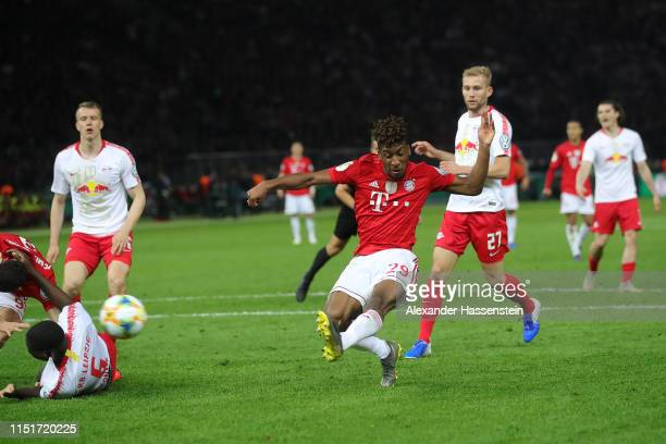 Kinglsey Coman of Bayern Muenchen scores the 2nd team goal during the DFB Cup final between RB Leipzig and Bayern Muenchen at Olympiastadion on May...