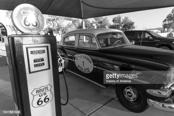 Kingman Arizona old Route 66 shows vintage Police Car and Gas Pump in black and white
