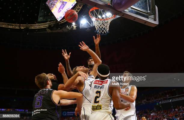 Kings and Bullets players contest possession during the round nine NBL match between the Sydney Kings and the Brisbane Bullets at Qudos Bank Arena on...