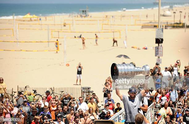 Kings center Jarret Stoll raises the Stanley Cup along the strand as the Hermosa Beach Chamber of Commerce and Visitors Bureau and the City of...