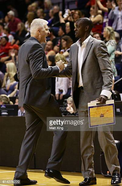 Kings coach Andrew Gaze and assistant coach Lanard Copeland celebrate victory during the round two NBL match between the Illawarra Hawks and the...