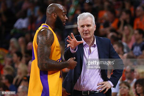 Kings coach Andrew Gaze and Joshua Powell talk during the round 10 NBL match between the Cairns Taipans and the Sydney Kings at the Cairns Convention...
