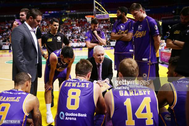 Kings coach Andrew Gaze speaks to his players during the round eight NBL match between the Sydney Kings and the Cairns Taipans at Qudos Bank Arena on...
