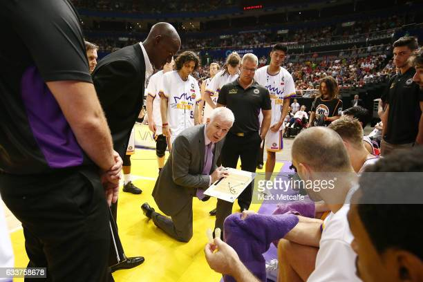 Kings coach Andrew Gaze talks to players in a huddle during the round 18 NBL match between the Sydney Kings and Melbourne United at Qudos Bank Arena...