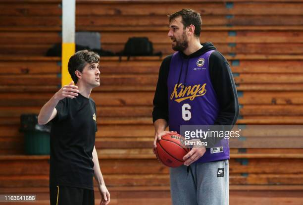 Kings coach Will Weaver talks to Andrew Bogut during the Sydney Kings preseason camp at Auburn Basketball Centre on July 23 2019 in Sydney Australia