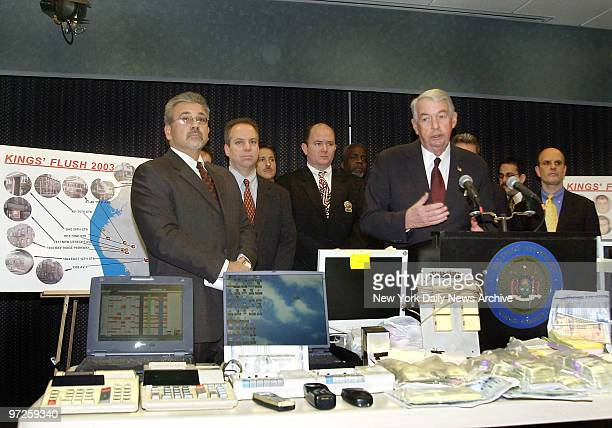 Kings County DA Charles Hynes at podium announces arrests for Super Bowl betting as part of Operation Kings Flush Computers cellphones and money were...