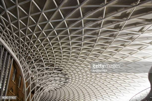 king's cross station concourse at night - ceiling stock pictures, royalty-free photos & images