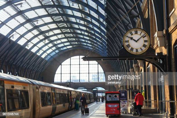 king's cross station, platform 9 3/4 | harry potter - station stock pictures, royalty-free photos & images