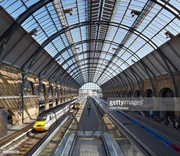 King's Cross trainshed London United Kingdom Architect Network Rail 2013 View from escalator landing to restored trainshed with vaulted steel and...