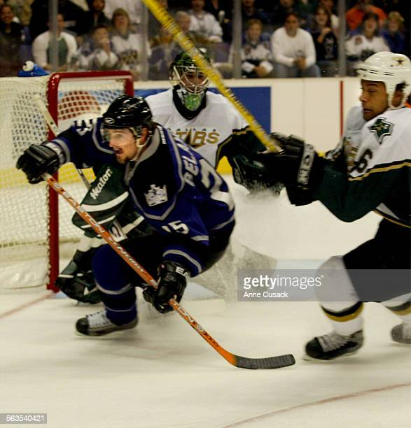 Kings Eric Belanger heads for the puck as @@#6 Trevor Daley defenseman with the Dallas Starsgoes on the attack in first period game action at Staples...