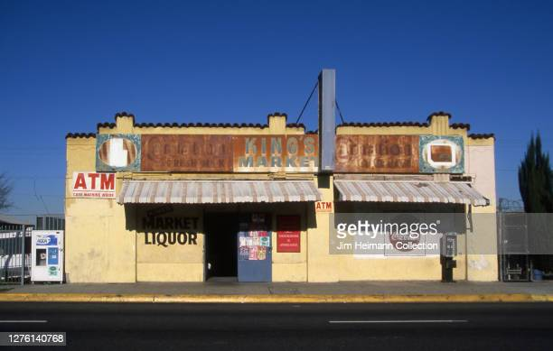 "King's Market in Los Angeles, California has an old, rusted sign that says ""Carnation Fresh Milk"" above the doorway , 2004."