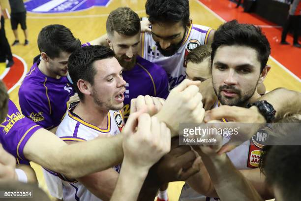 Kings players celebrate victory in the round four NBL match between the Illawarra Hawks and the Sydney Kings at Wollongong Entertainment Centre on...