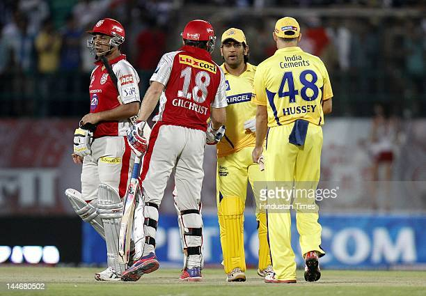 Kings XI Punjab batsman Adam Gilchrist and Azhar Mehmood congratulated by Chennai Super Kings captain MS Dhoni on their victory during IPL Twenty 20...