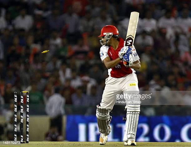 Kings XI Punjab batsman Nitin Saini bowled out by Royal Challengers Bangalore bowler Zaheer Khan during IPL5 T20 Cricket match played between Kings...