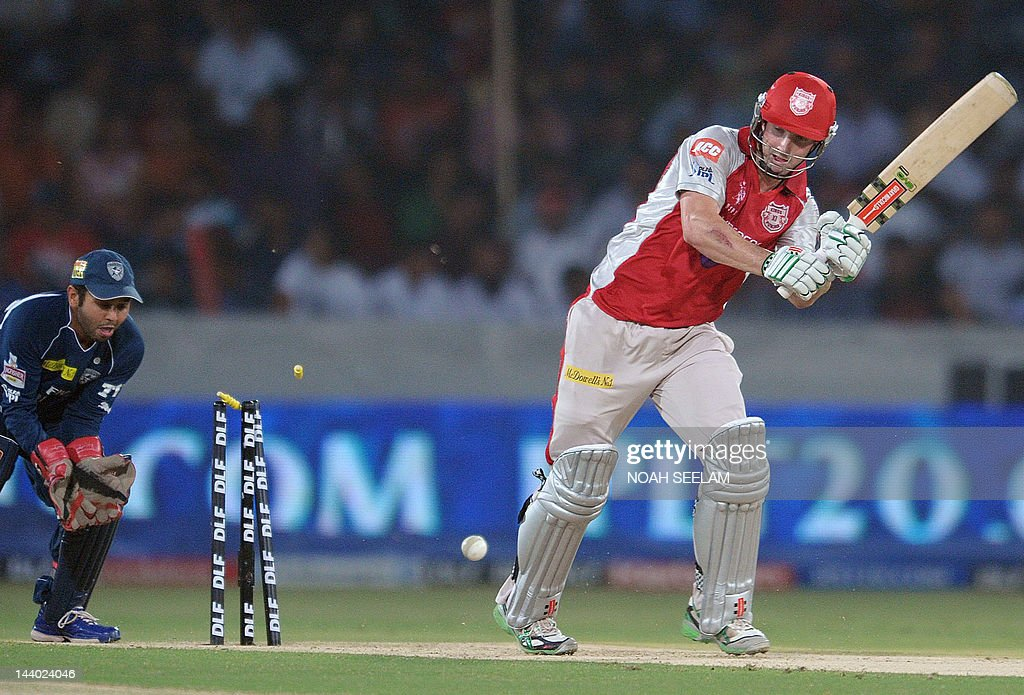 Kings XI Punjab batsman Shaun Marsh (R) is bowled out by Deccan Chargers bowler Shikar Dhawan during the IPL Twenty20 cricket match between Deccan Chargers and Kings XI Punjab at the Rajiv Gandhi International Stadium in Hyderabad on May 8, 2012. RESTRICTED TO EDITORIAL USE. MOBILE USE WITHIN NEWS PACKAGE. AFP PHOTO / Noah SEELAM