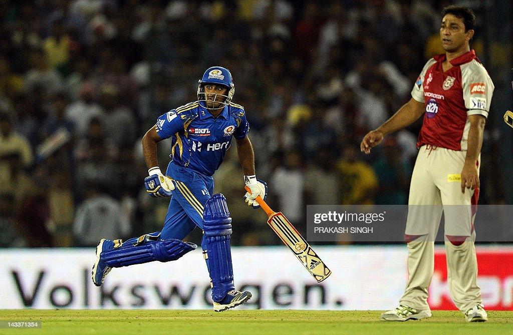 Kings XI Punjab bowler Azhar Mahmood (R) watches as Mumbai Indians Batsman Ambati Rayudu takes a run during the IPL Twenty20 cricket match between Kings XI Punjab and Mumbai Indians at PCA Stadium in Mohali on April 25, 2012. RESTRICTED TO EDITORIAL USE. MOBILE USE WITHIN NEWS PACKAGE AFP PHOTO/ Prakash SINGH