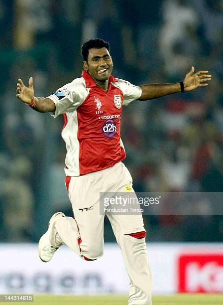 Kings XI Punjab bowler Parvinder Awana celebrates after dismissal of Deccan Chargers captain Kumar Sangakkara during the IPL T20 cricket match played...