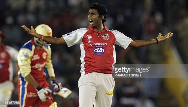 Kings XI Punjab bowler Parvinder Awana celebrates taking the wicket of Royal Challengers Bangalore batsman Mayank Agarwal during the IPL Twenty20...