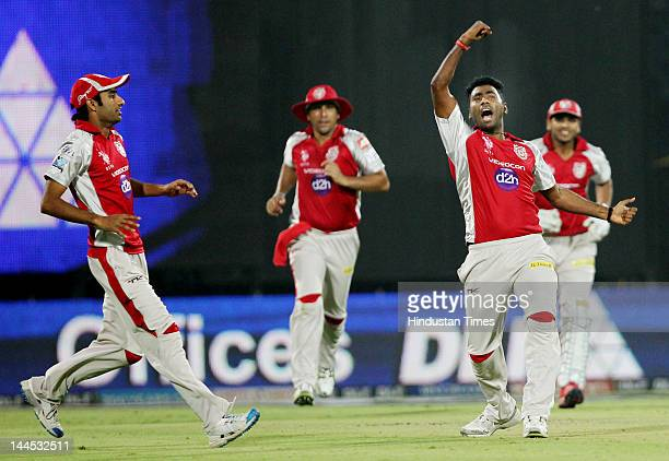 Kings XI Punjab bowler Parvinder Awana celebrates the dismissal of Delhi Daredevils Captain Virendra Sehwag during the IPL cricket match between...