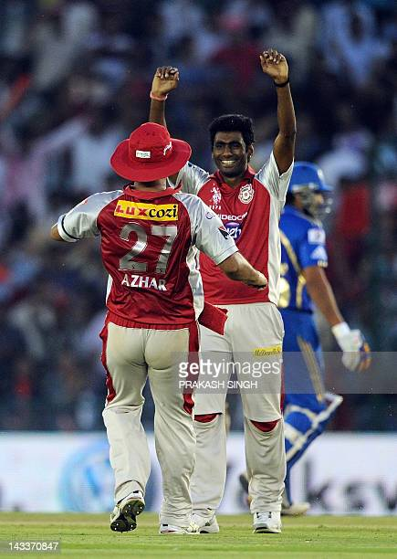 Kings XI Punjab Bowler Parvinder Awana celebrates the wicket of Mumbai Indians Batsman Kieron Pollard during the IPL Twenty20 cricket match between...