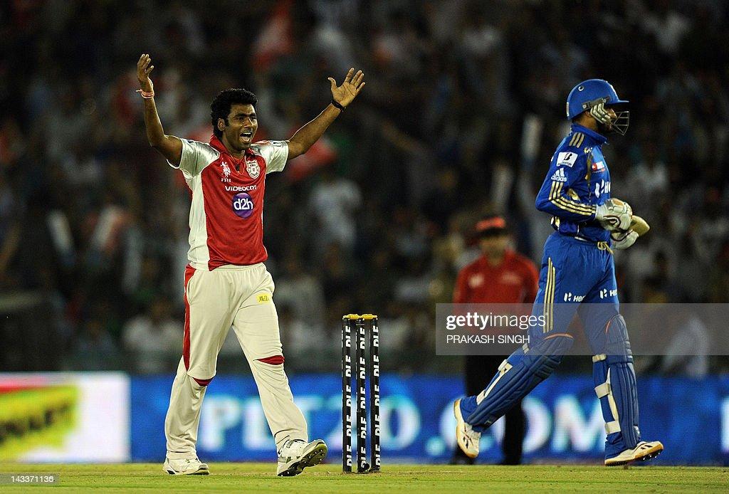 Kings XI Punjab bowler Parvinder Awana (L) celebrates the wicket of Mumbai Indians batsman Harbhajan Singh during the IPL Twenty20 cricket match between Kings XI Punjab and Mumbai Indians at PCA Stadium in Mohali on April 25, 2012. RESTRICTED TO EDITORIAL USE. MOBILE USE WITHIN NEWS PACKAGE AFP PHOTO/ Prakash SINGH