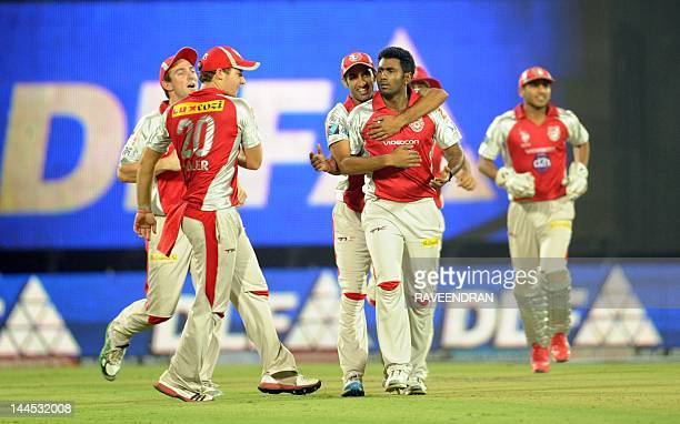 Kings XI Punjab bowler Parvinder Awana celebrates with his teammates after taking the wicket of Delhi Daredevils batsman Ross Taylor during the IPL...