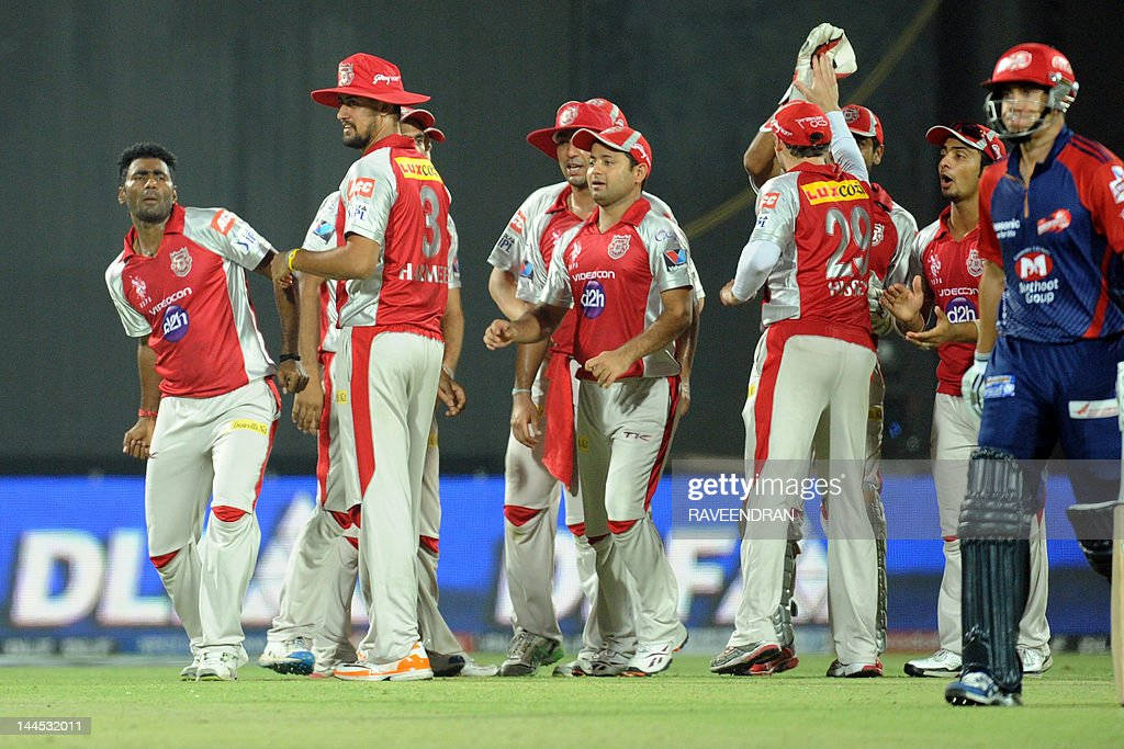Kings XI Punjab bowler Parvinder Awana (L) celebrates with his teammates after taking the wicket of Delhi Daredevils batsman Ross Taylor (R) on May 15, 2012 during the IPL Twenty20 cricket match at the Ferozshah Kotla ground in New Delhi.