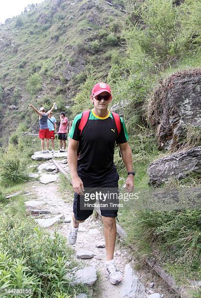 Kings XI Punjab captain Adam Gilchrist along with some teammates go on a trek from Dharamkot to Bhagsunag near Mcleodjang on May 18 2012 in...