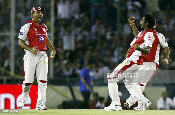 Kings XI Punjab Player Parvinder Awana celebrate the dismissal Royal Challengers Bangalore batsman Saurabh Tiwaril during IPL5 T20 Cricket match...
