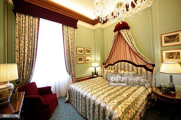 A kingsized bed sits inside a guest suite at the Lanesborough luxury 5star hotel operated by the Oetker Group in London UK on Friday July 10 2015...