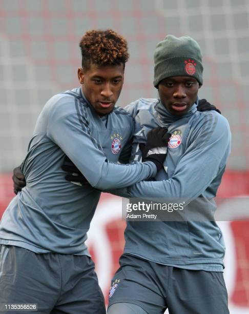 Kingsley Coman and Alphonso Davies jostle during a Bayern Muenchen training session at Saebener Strasse training ground on March 12 2019 in Munich...
