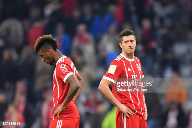 Kingsley Coman and Robert Lewandowski of FC Bayern Muenchen stand next to each other after the Bundesliga match between FC Bayern Muenchen and VfL...